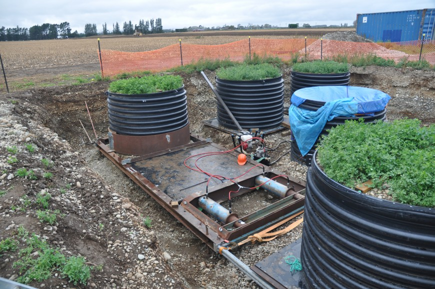 Installing large lysimeters containing undisturbed soil monoliths established with lucerne for direct measurements of carbon and nitrogen leaching. The lysimeters are 2 m in diameter and 1.5 m deep. Note the high stone content of the soil (John Payne)