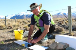 Dr Grant Norbury sets a tracking tunnel to monitor predator abundance