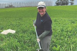 Dr Kara Allen collecting topsoil samples