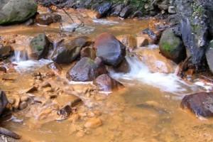 Acid mine drainage from a coal mine.
