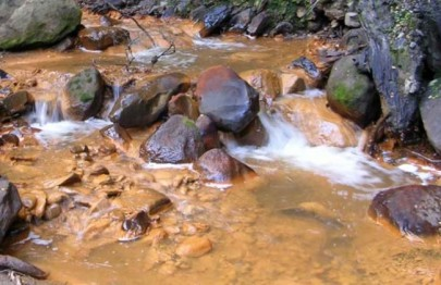 Acid mine drainage from coal mine.