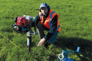 Dr Paul Mudge driving in a soil core, Tarras, Central Otago