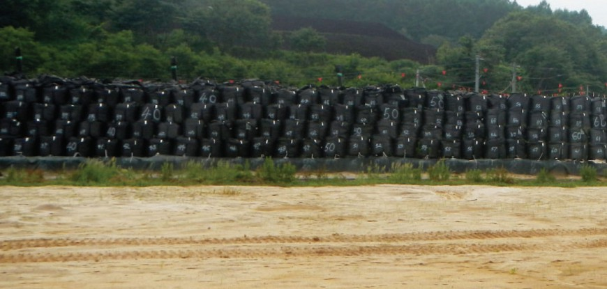 Contaminated soil in storage following decontamination (removal of topsoil)