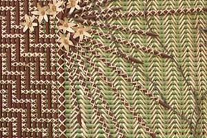 Painted kākaho held together by kiekie in tukutuku panel, Te Aitanga ā Tāne, created by Mae Taurua. In Allan Herbarium, Manaaki Whenua, Lincoln. Image: Sue Scheele